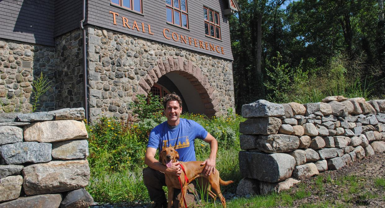 Dia the Conservation Detection Dog and her handler Joshua Beese. Photo by Heather Darley.