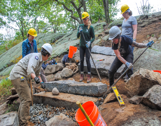 Volunteers set steps on the Appalachian Trail at Bear Mountain. Photo by Heather Darley.