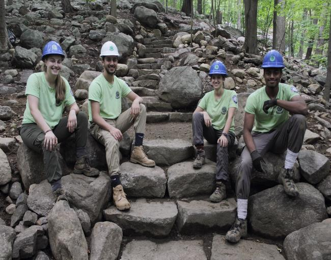 Sweet Water Trail Crew proudly sitting on their stone steps built on the Ramapo Valley County Reservation Vista Loop. Photo by Brayden Donnelly.